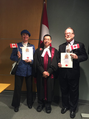 Jim DeLaHunt and Ducky Sherwood at the oath-affirmation ceremony, with Judge Roy Wong.