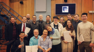 Image of several people including Jim DeLaHunt and Christopher Tin