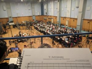 Room with chorus, score in foreground